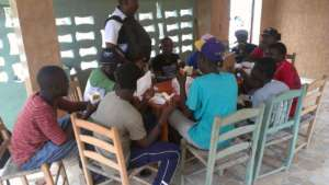 Staff and police meeting with youth-at-risk