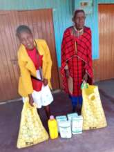 Maria and her mother receiving food gift