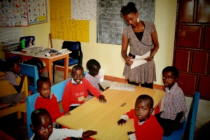 Pre-school children with their teacher, Ann