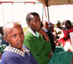 Sponsored children listen to their Governor