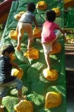 Umang beneficiaries experiencing rock climbing.