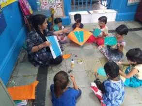 Kite making activity with Umang beneficiaries.