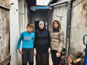 Muhamet and Shkurta with their mother, Vahide