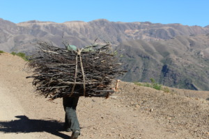 A man from one community carrying his fuel
