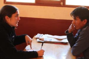 Caroline interviewing a teacher in Vacaqueria