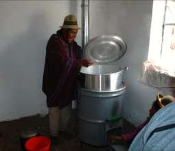 A man cooks with an institutional rocket stove