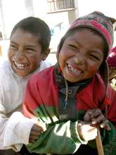 Two schoolboys share a laugh