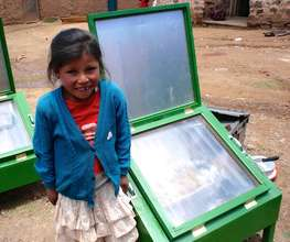 A young girl with her family's new solar cooker!