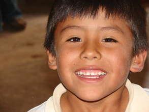 Adorable schoolboy smiles for the camera!