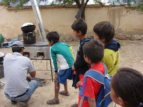 Children learn how to use rocket-stove