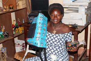 Artisan Leonie supports her 3-year old son