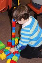 Child enjoys a blocks activity
