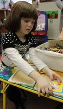 Child enjoys her puzzle activity