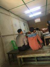 A juvenile defendant awaits trial in Yangon
