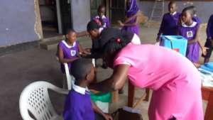 Nyaka students receiving Measles immunization