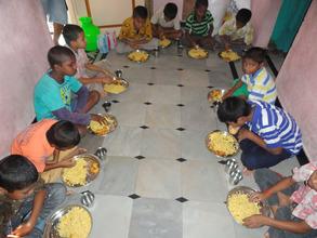 abandoned orphans having food at joyhome orphanage