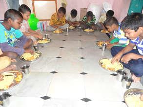 abandoned orphan children enjoying with breakfast
