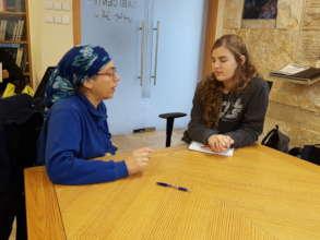 An academic mentor (senior vet) advises a student