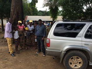Shed Jah delivers supplies to a Kidsave family