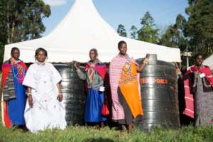 Indigenous women in Kenya receive water tanks