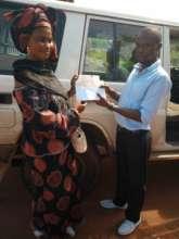 Umu's mother receives Hardship Fund donation