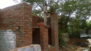 Toilet construction in progress in Amit garage