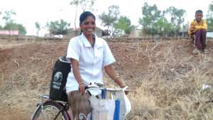 Nita on her bicycle with the nitrogen container 1