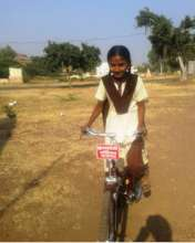 Trupti with her bicycle
