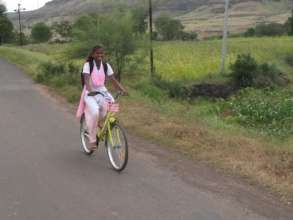 Diksha with her bicycle