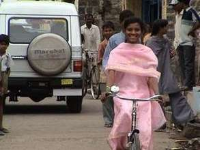 Asma Raman Tamboli with her bike from Mann Vikas