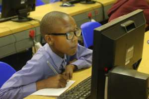 Learner completing his assessment