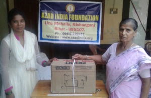 Anjuma  receiving machine from AIF Chairperson