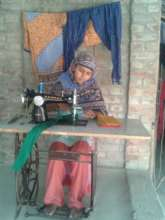 Hasina working at her home