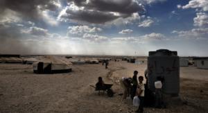 Children fetch water from a waterhole in Za'atari