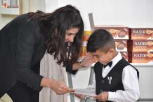 Boy receiving certificate