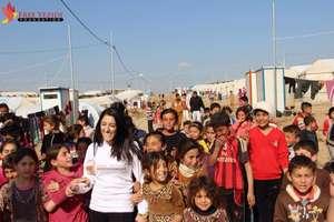 FYF Founder Pari Ibrahim with Yezidi children