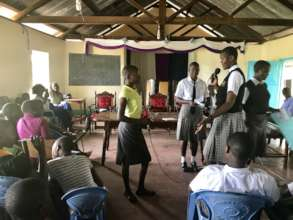 Josephine leads an SRH workshop for younger girls