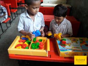 Children exploring ways to stack blocks