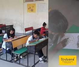 Children play Word Search before class begins