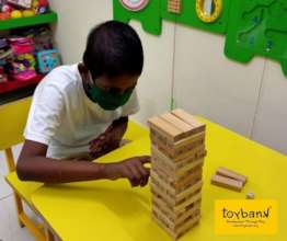 A child plays Jenga at Play2Smile partner hospital