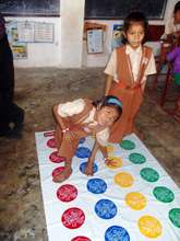 Children playing twister at a Rural School Center
