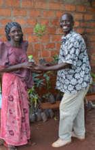 Uganda Program Director Edward distributing trees