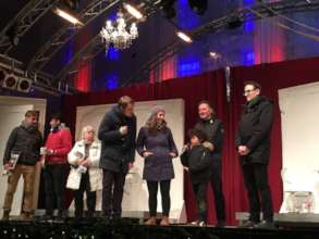 Mentor and mentee on the stage at christmas market