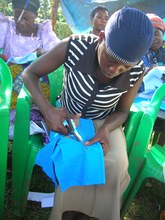 A girl makes her own pad during the training