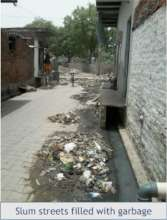 A regular sight for slum youth - garbage in lanes