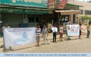 Slum children spread messages through placards