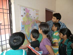 Children's groups learning Geography on Maps