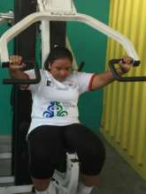 Blind Female powerlifter training at BSF
