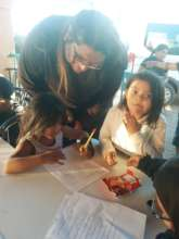 River mentors the young students in our programs