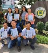 Visayas State Univ. scholars hold their awards